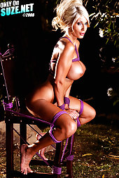 Naked Puma Swede Tied to a chair outside
