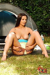 Horny brunette babe Eve Angel showing her pussy outdoors